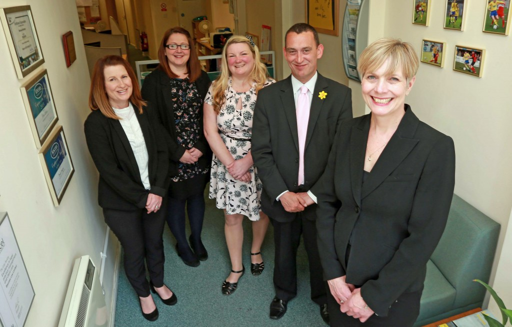 HERE TO HELP: Kate Knight, who leads the Gosport office of Biscoes, front, with, from left, Jen Derrick, Louise Roberts, Rachel Lees and Gary Morgan