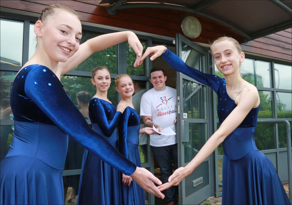 Students of the Parkewood School of Dance visited Wessex Heartbeat House to register the first entry for the charity's new talent show. Pictured are Charlotte Farrett-Poulton and Izzy Tyler (front), Callum Munro (Fundraising officer, Wessex Heartbeat) receiving their form from Genevieve Dodson and Jasmine Arber.