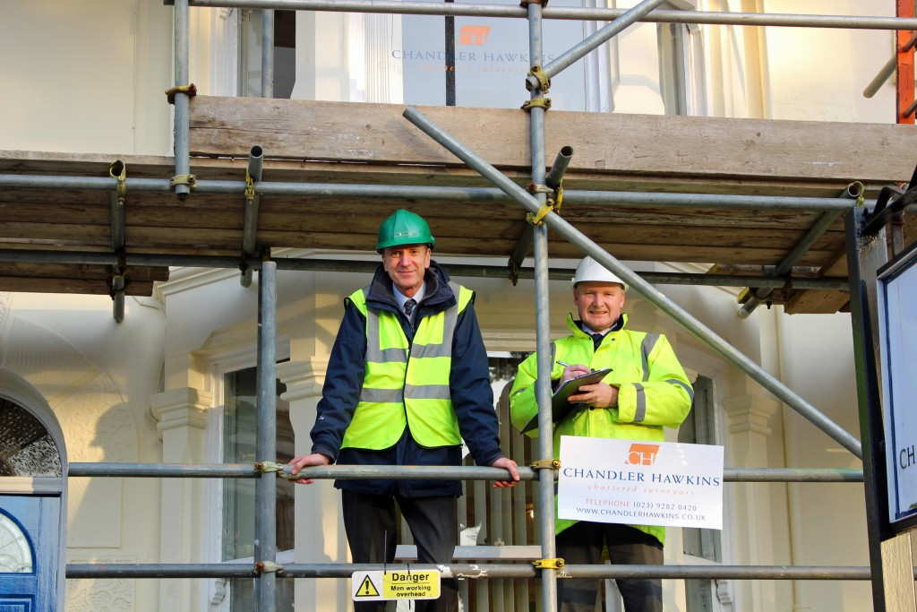 VITAL WORK: Peter Chandler, left, and Neil Hawkins of chartered surveyors Chandler Hawkins, on scaffolding outside their headquarters in Landport Terrace, Portsmouth, which has undergone a major refurbishment