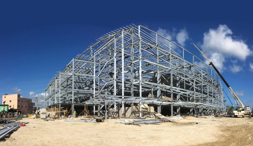 ON THE BALL: Steel work goes up at Belize City's new sports centre