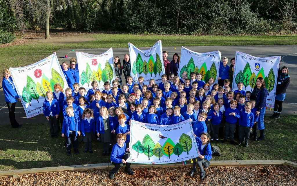 Pupils and staff from the Heath Academy Trust embarked on a week long flag making workshop involving every school within the trust. Pictured are pupils from Three Legged Cross First School with staff and the team from Prior Made who organised the activity.