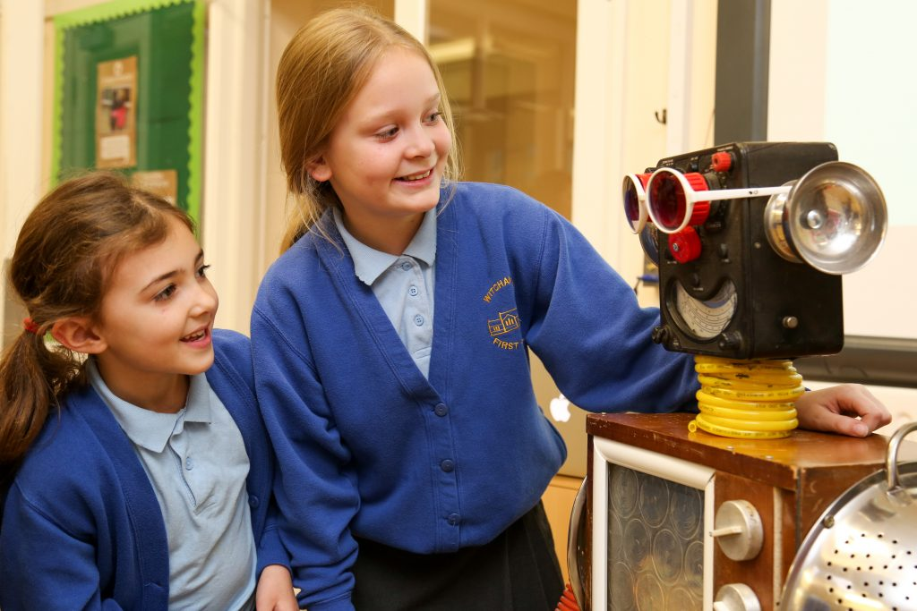 Pete Sheath, South-East Regional lead for Heart Smart brings Boris the robot to meet the children at Witchampton First School. Pupils Abigail Thacker and Amelia Stapley meet Boris.
