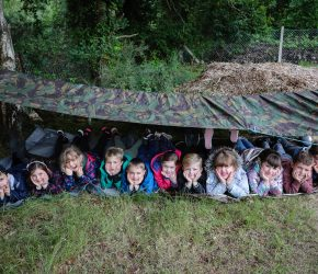 Pupils take shelter this inclement summer