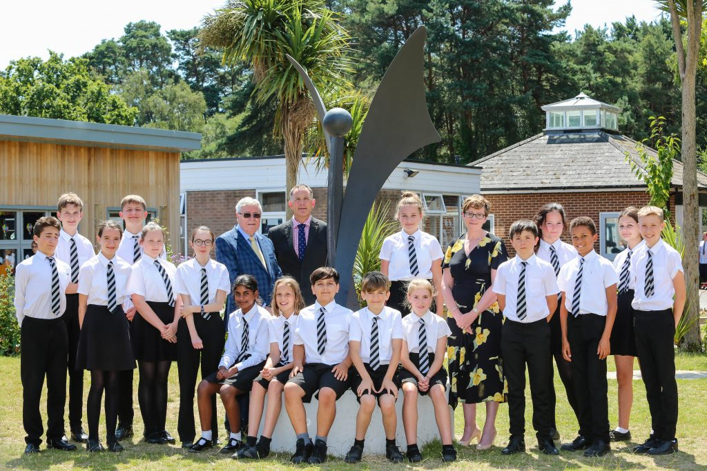 Following their excellent SIAMS inspection,  pictured with pupils at St Michael's CE Middle School are Wimborne Academy Trust Chair of Trustees John Dickson, Headteacher Ron Jenkinson and Wimborne Academy Trust CEO Liz West.