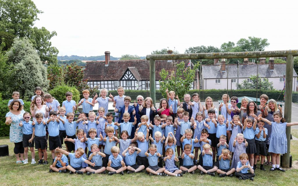 Children and staff at Witchampton Church of England First School join Wimborne Academy Trust leaders to celebrate an excellent SIAMS inspection.