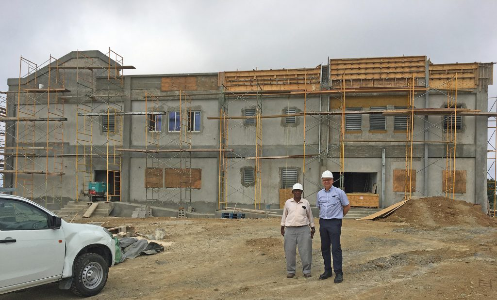 STEEL STRONG: From left: Hesketh Newton, managing director of Newton Construction Co Ltd, and REIDsteel commercial director Tim Cook outside the front of new Enis Adams primary school in Tortola in the British Virgin Islands