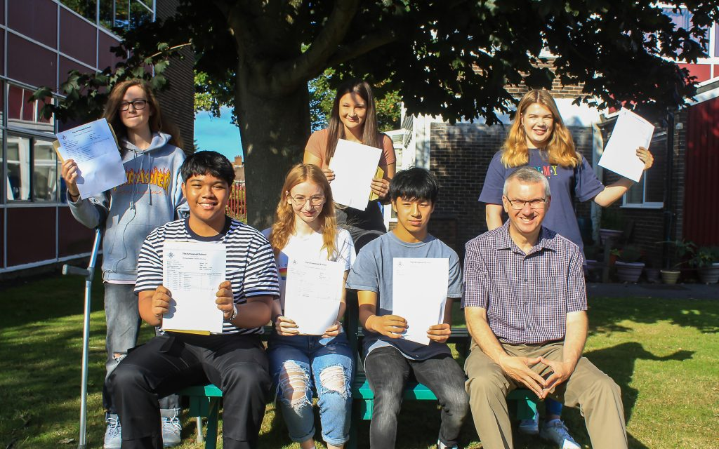 Students from the Arnewood School celebrate their excellent GCSE results. with headteacher Nigel Pressnell. From left tp right : Hannah Gorry, Kit Narito, Matilda Gleave, Ruby Watts, Ben Bang, headteacher Nigel Pressnell, Anya Miller.