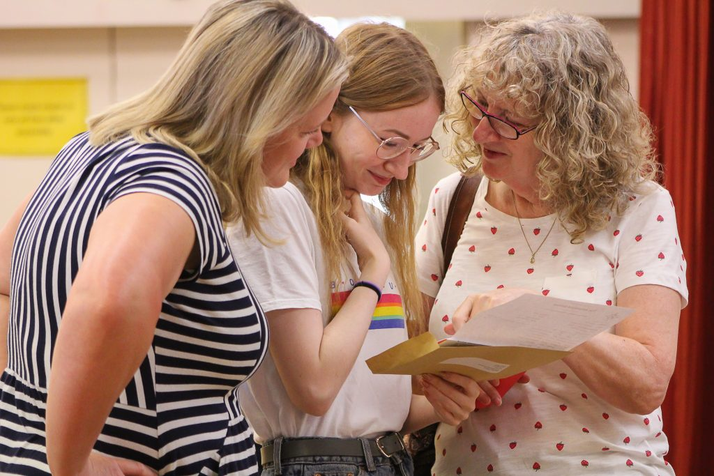 Students from the Arnewood School celebrate their excellent GCSE results. Student Matilda Gleave shares the news she achieved an impressive six grade 9s with her teadcher Kim Watson (left) and proud mum Margaret Gleave (right).
