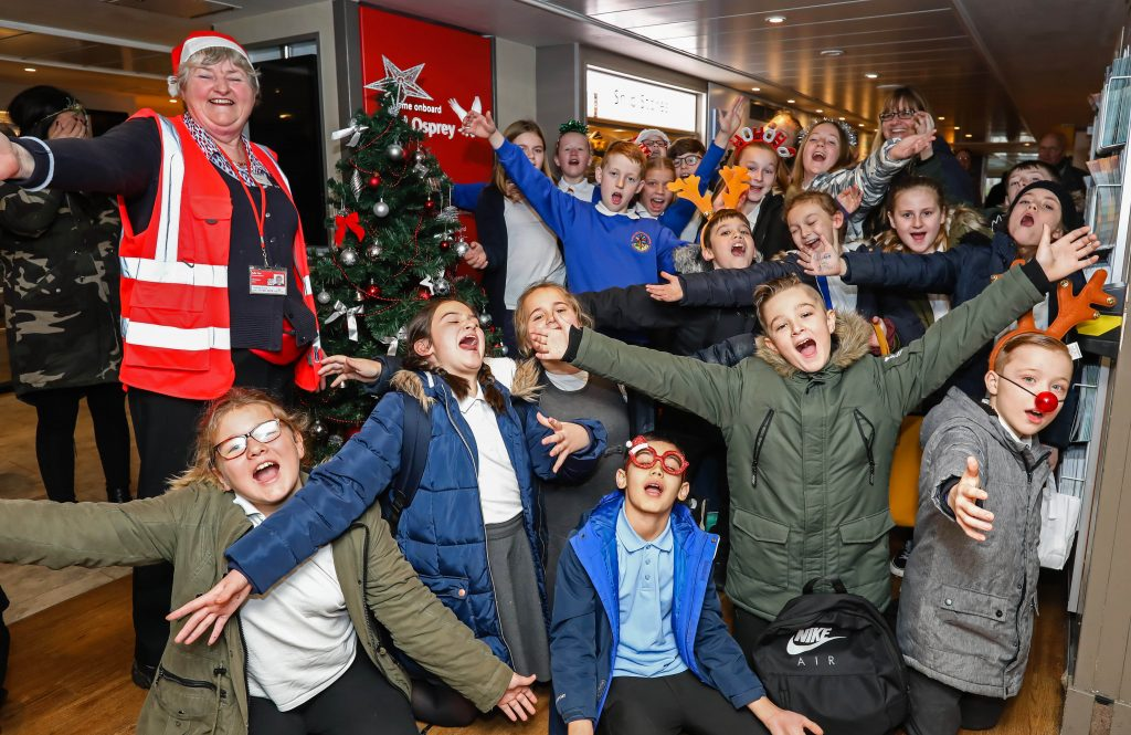 Kanes Hill Primary School pupils sang Christmas songs to passengers on the Red Funnel ferry Red Osprey from Southampton to East Cowes.