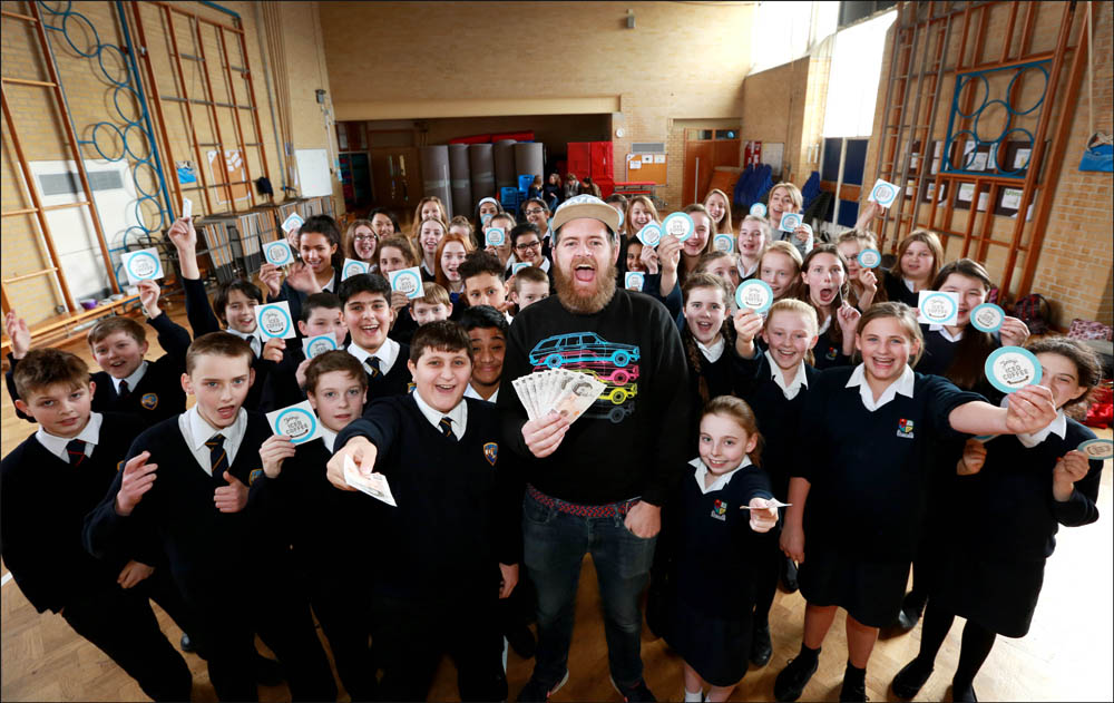 Jimmy Cregan of Jimmy's Iced Coffee joins pupils from Avonbourne and Harewood Colleges to officially launch their Tenner competition.