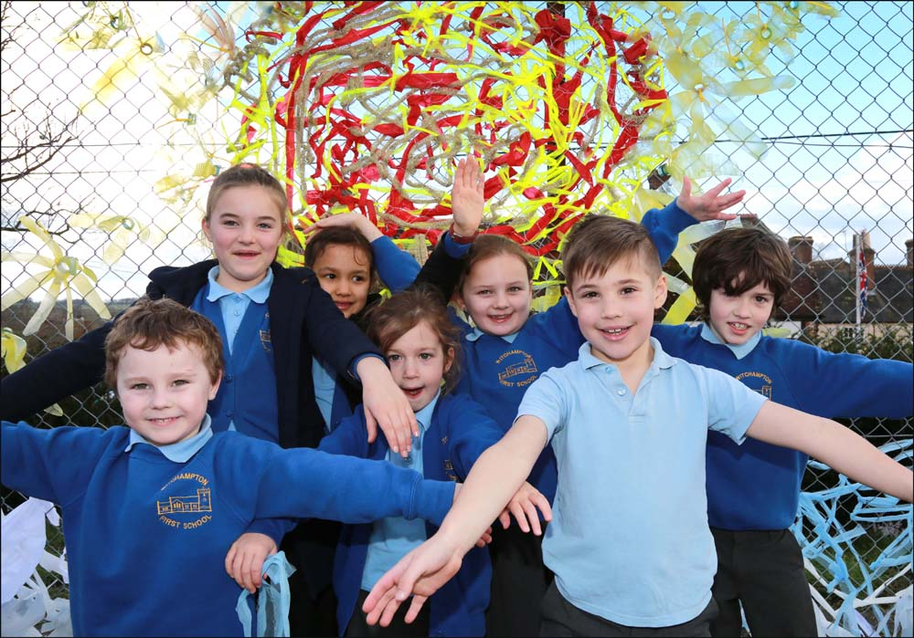 Witchampton First School pupils created a scene of sun, rainbows and clouds from recycled materials to decorate their playground.