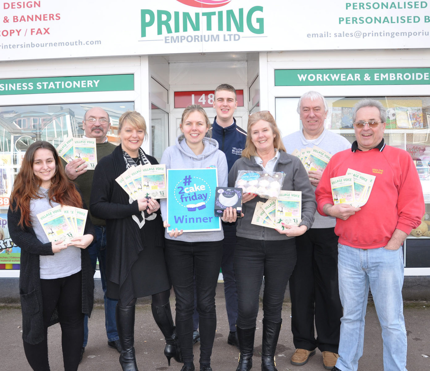 Traders behind Kinson's Village Voice magazine receiving their cakes from Fiona Harwood (third from left) and Ollie Wheatley (at the back).