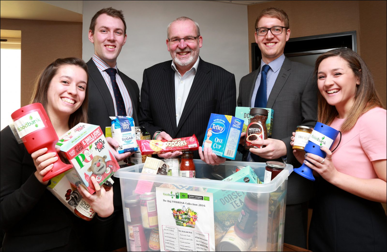 Ellis Jones' Managing Partner Nigel Smith with (left to right) Annie James, Simon Beetham, Mark Stutter, Bethanie Watson and some of the items donated to Bournemouth Foodbank.