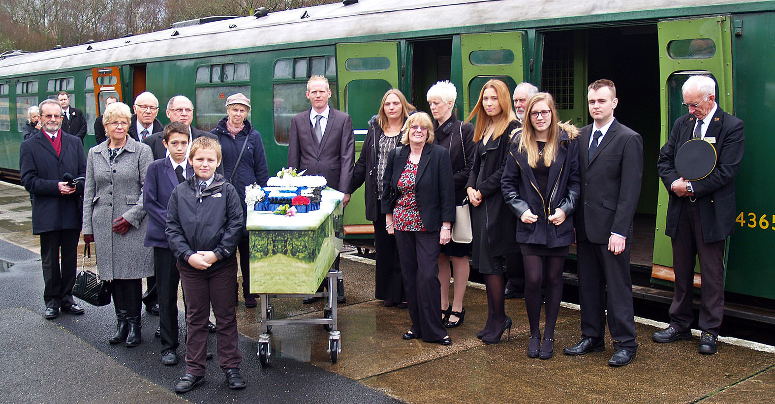 Rail enthusiast Mike Stollery who volunteered on the Swanage steam railway in Dorset for 44 years was taken to his funeral in a carriage he had restored himself. His coffin is pictured here before his final journey with relatives and friends.
