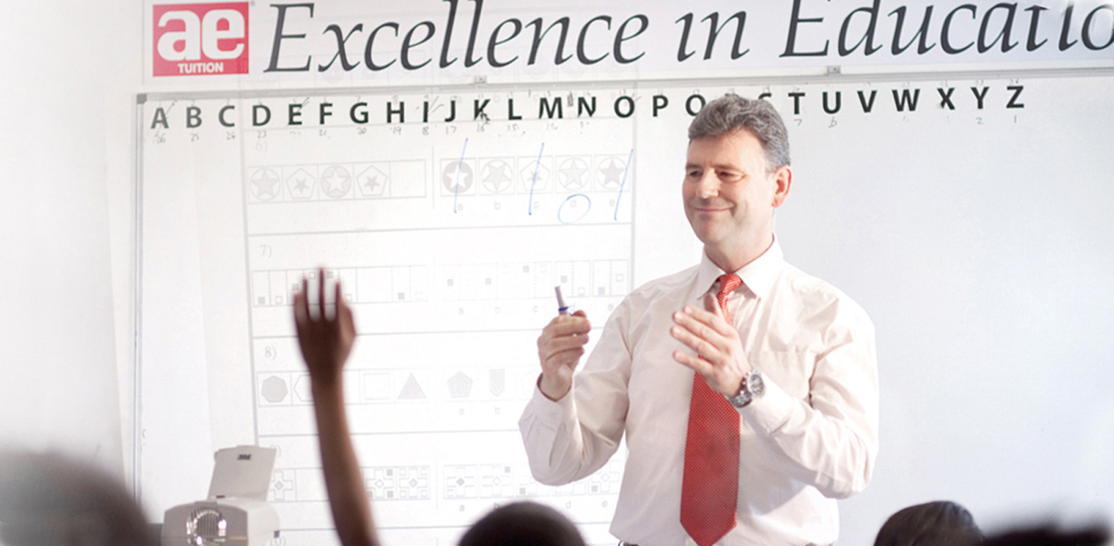 Dr Stephen Curran teaching at his current tuition centre in Slough. He is about to open a second tuition centre in the town to meet growing demand.