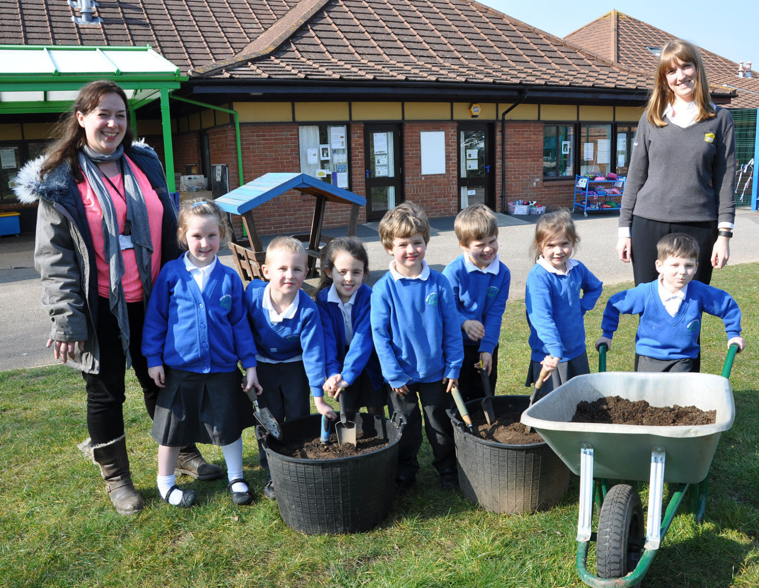 Super donation: Eco's Charlotte Haswell (right) and Anna Weston, Winton Primary School's Green Coordinator, with reception pupils from 'Plum' class.