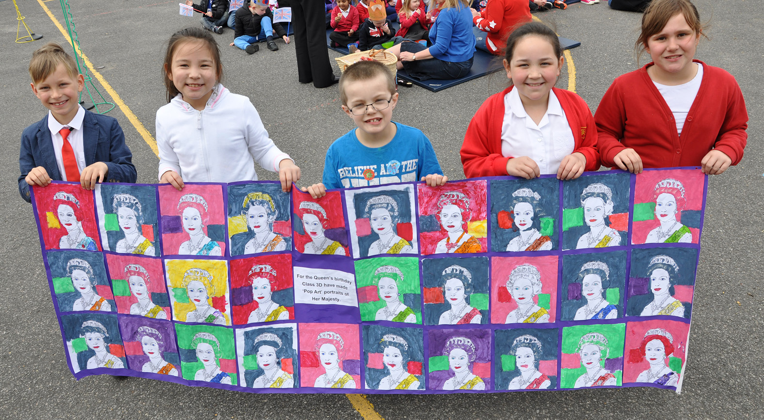 The children from Elm Academy celebrated the Queen's 90th birthday with a street party and a day of royal-themed activities.  Lewis Cavanagh-Collins (centre) who shares his birthday with the Queen. His class made this pop art tribute.