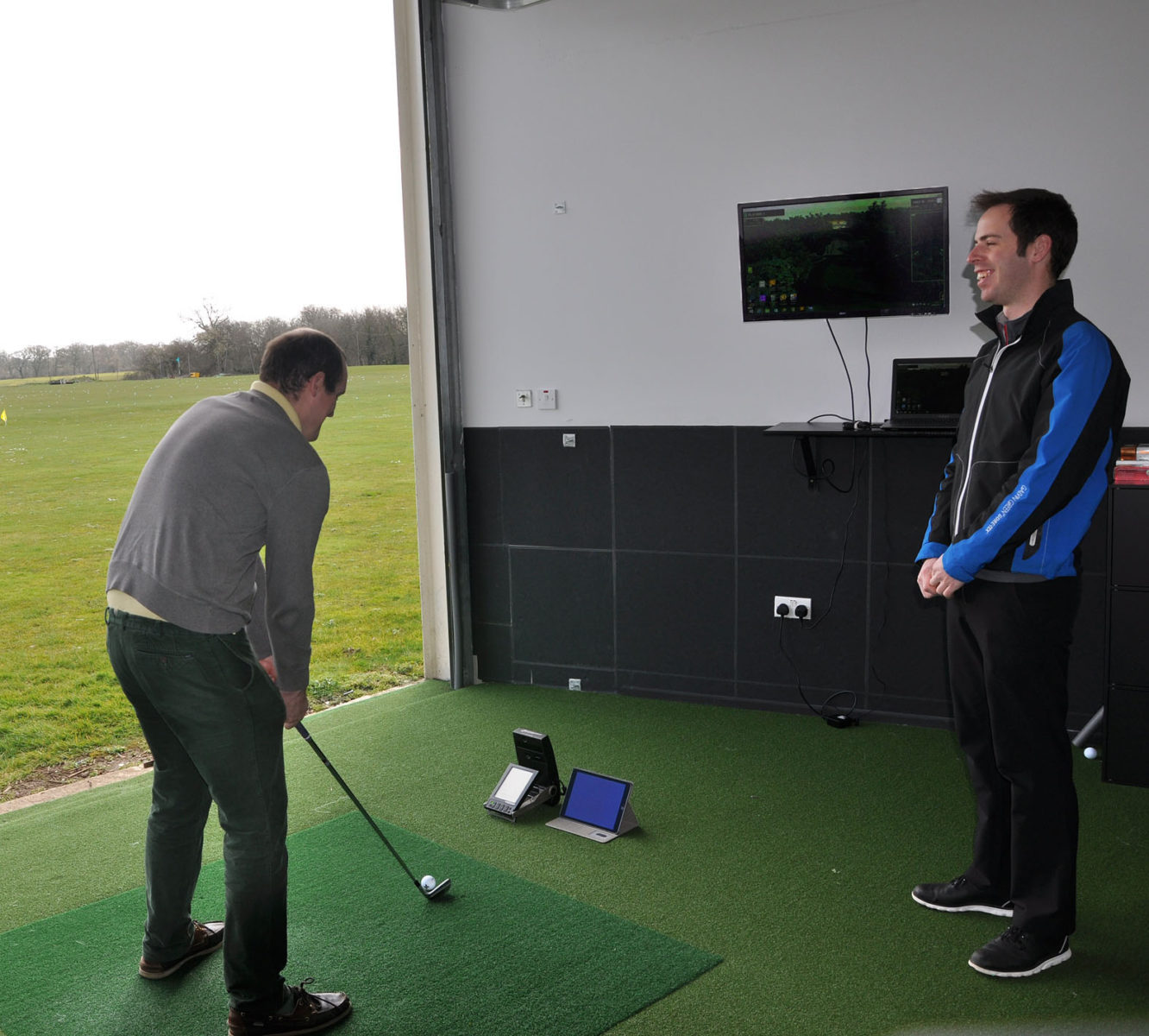 Parley Golf Centre's simulator is a huge success and golfers can now use it and see their balls go the full distance because it opens up to the driving range behind. Here, Parley Golf pro Andrew Warren coaches using the equipment.