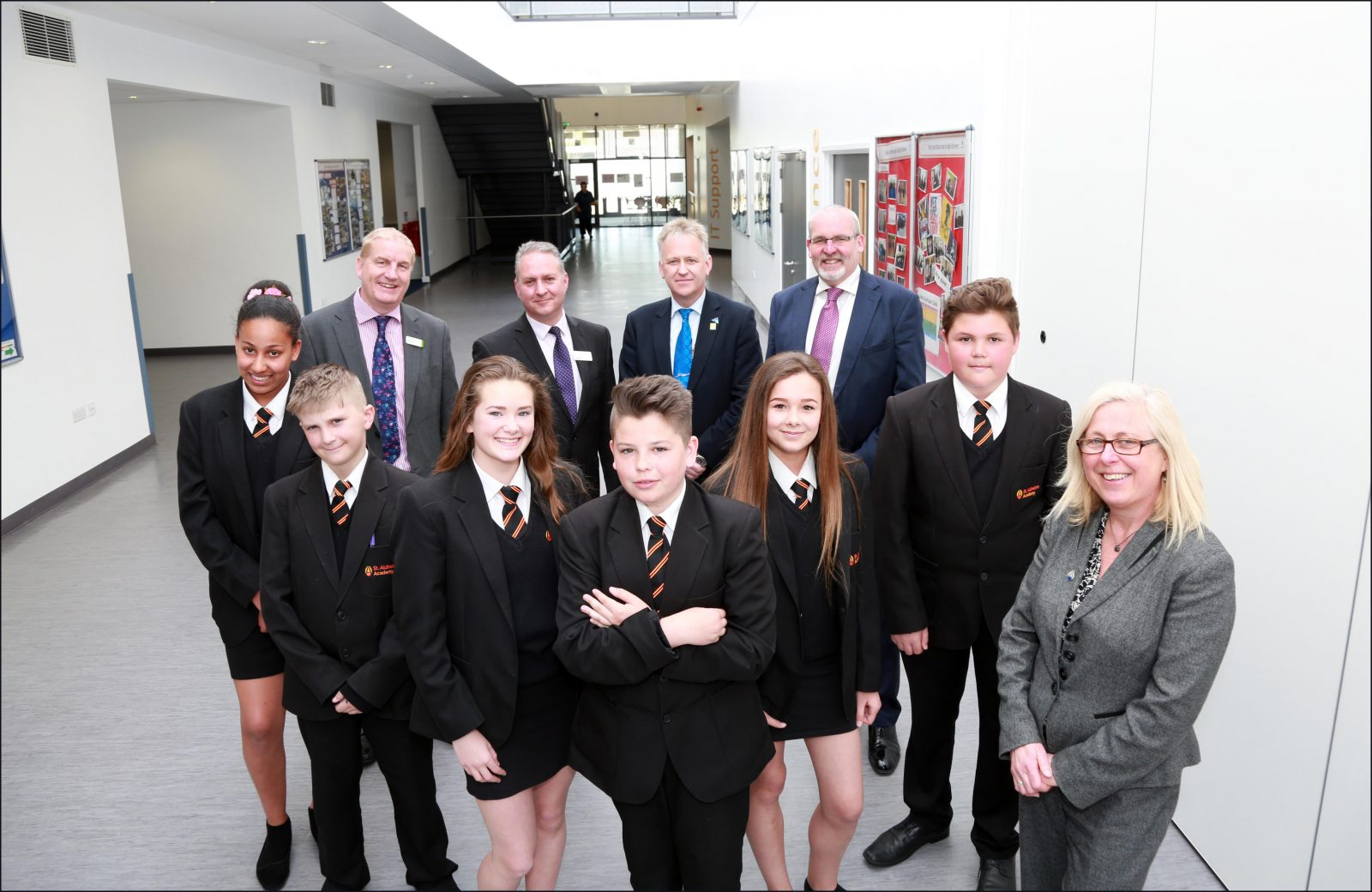 Dorset Chamber of Commerce and Industry paid a visit to St Aldhelm's Academy, pictured with pupils are David McNair director of Nuffield Health Bournemouth Hospital, DCCI chief executive Iain Girling , AAT CEO Brian Hooper, Ellis Jones managing partner Nigel Smith and St Aldhelms principal Sian Thomas.