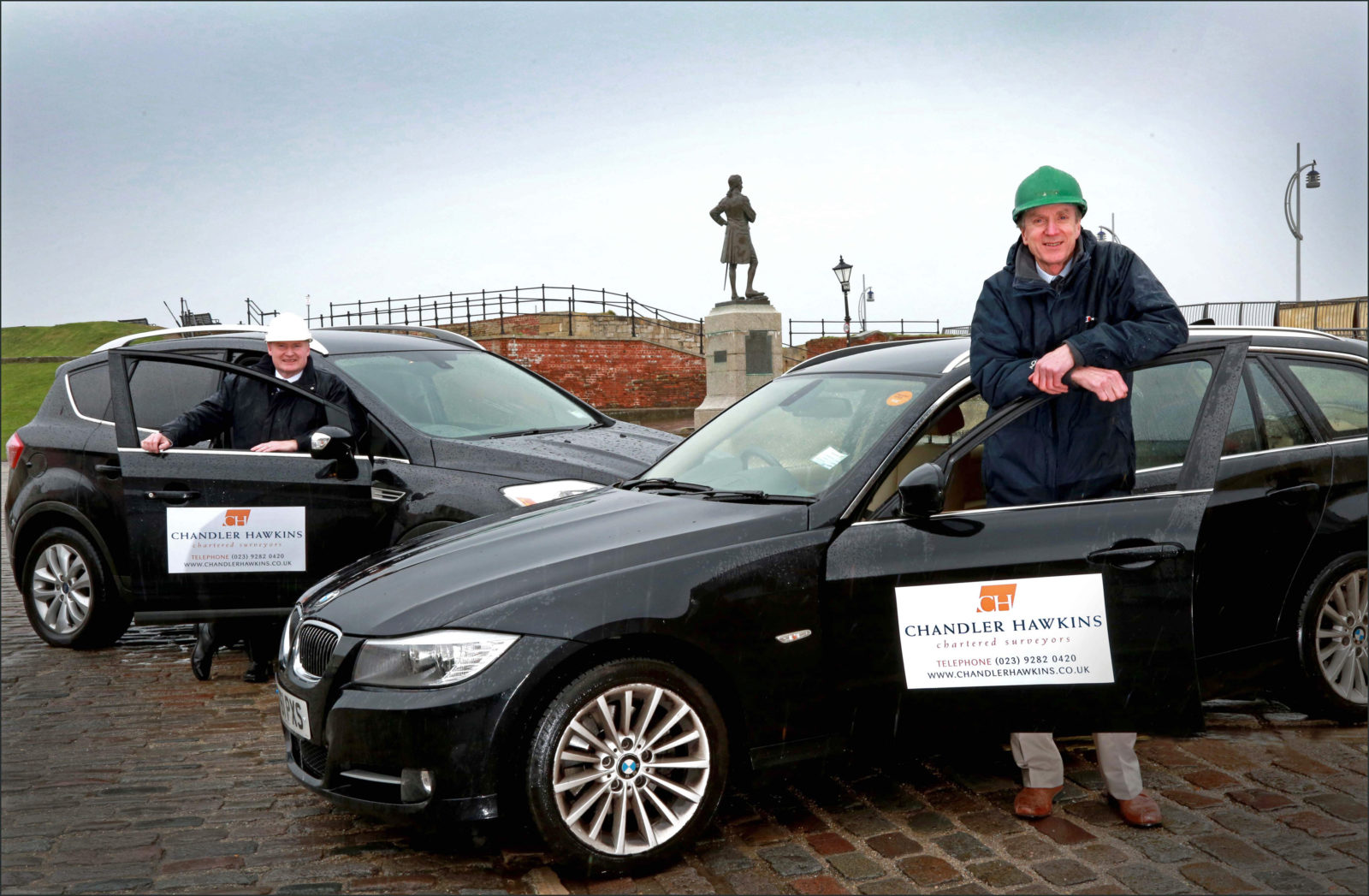 Chandler Hawkins launch logo branding on their company cars, Neil Hawkins and Peter Chandler are pictured with the vehicles in Portsmouth.