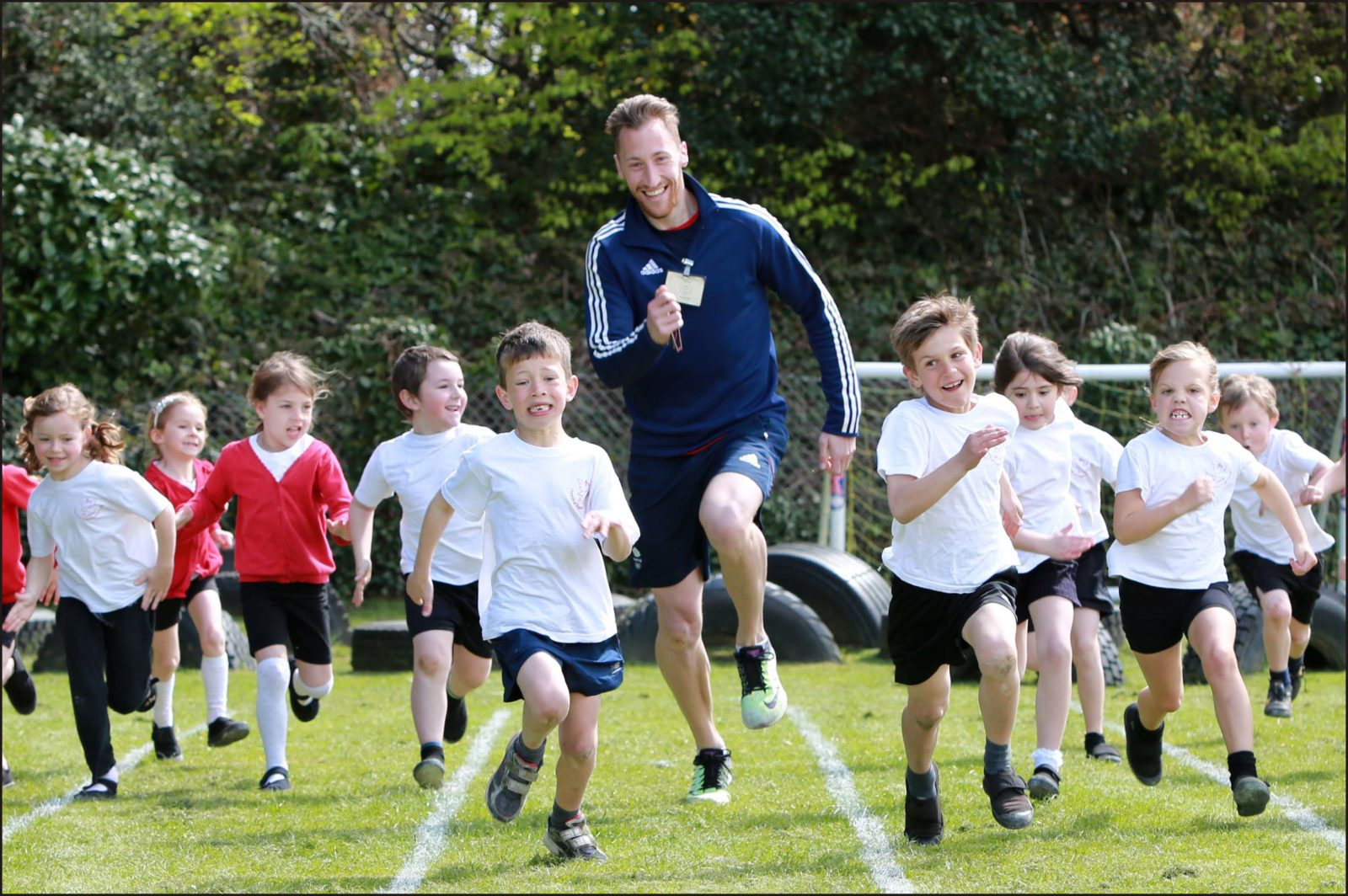 Olympic athlete Gareth Hopkins was a guest at St John's C of E First School in Wimborne where he put the pupils through their paces. Gareth runs with year 2 pupils.