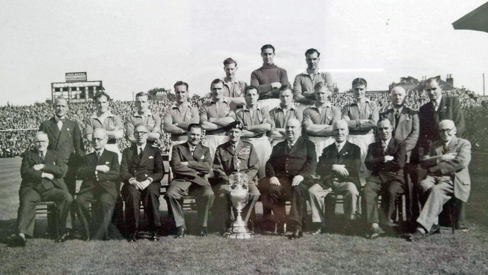 PLAY UP POMPEY: Field Marshall Montgomery with the Division One championship trophy with Mr Chinneck to the right