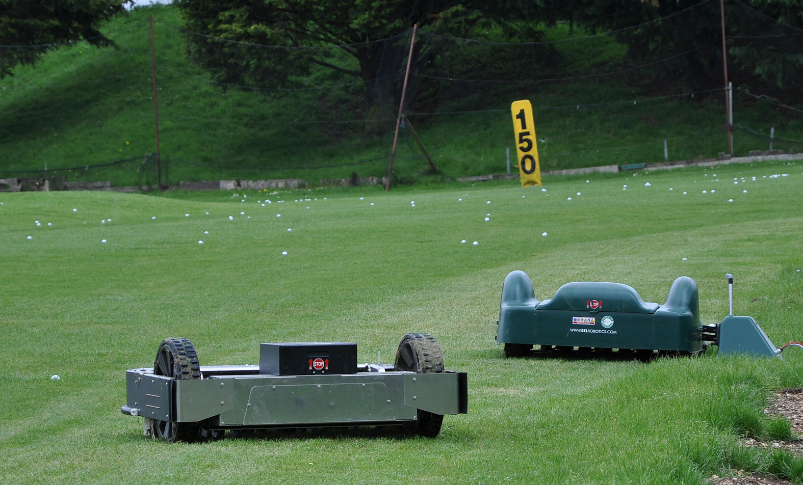 Parley Golf Centre's two new robots - the one in the oreground collects the balls on the driving range and the other cuts the grass.