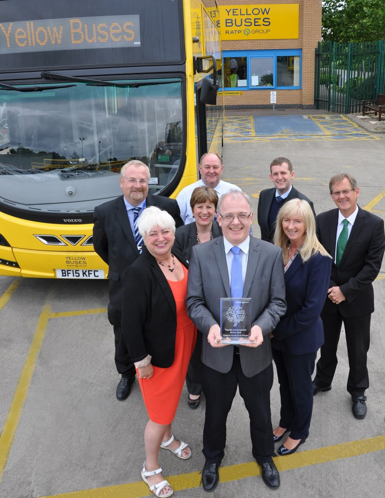 Mike Conroy, Yellow Buses' Operations Manager, with the 'staff transport' trophy, and the Yellows' team responsible.