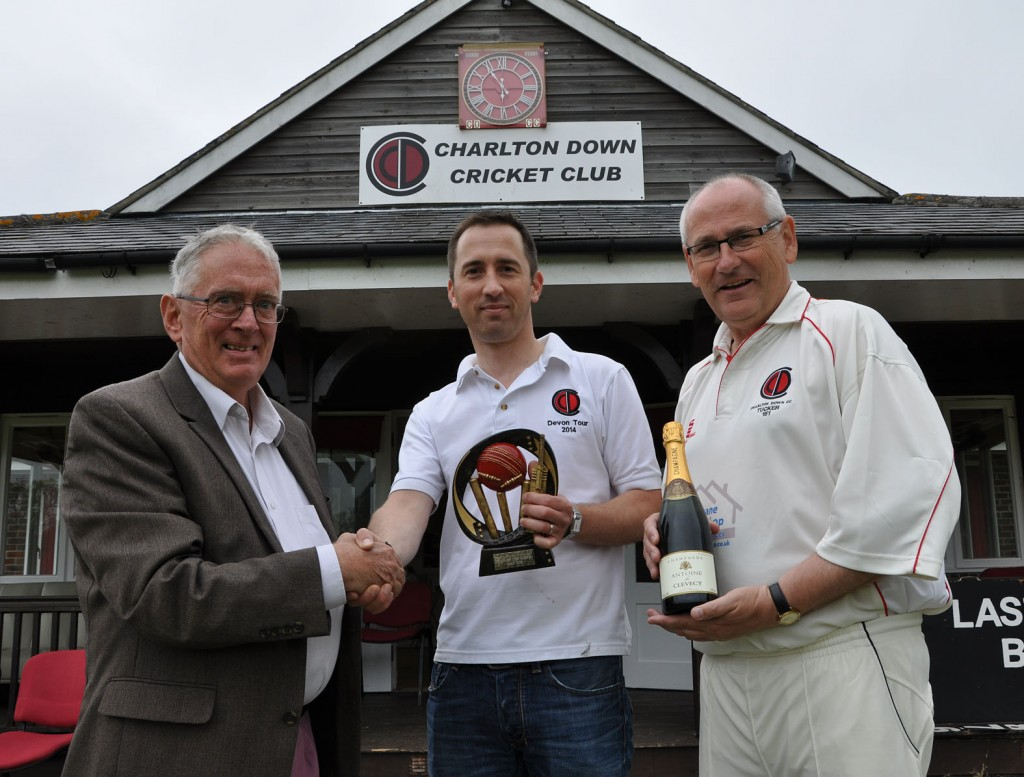 Peter Douch, left from the Dorset Funeral Plan - sponsors of Dorset Saturday cricket leagues - with (centre) Alex Campbell, chairman of Charlton Down CC, and its skipper Tommy Tucker. The team won the May team of the month award.