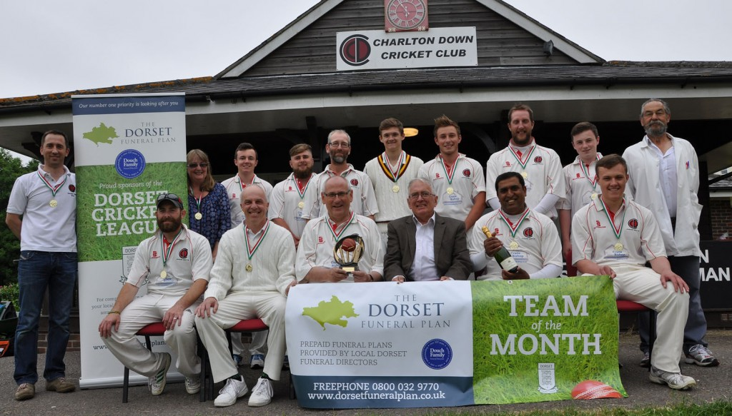 Peter Douch, centre, sitting, from the sponsors The Dorset Funeral Plan, and Charlton Down CC