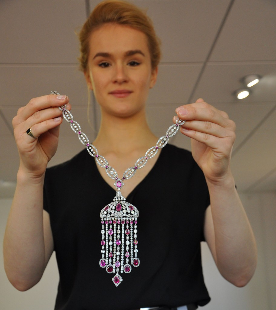 Maddi Puleston of Duke's auction house in Dorchester with a historic necklace that is estimated to sell for £60,000.
