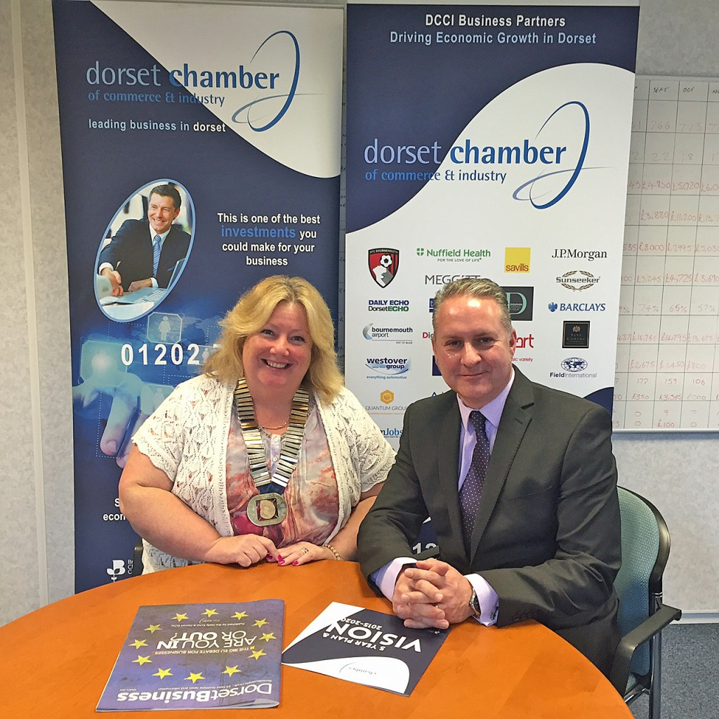 STRONGER: Ian Girling, DCCI's chief executive and Swanage president Caroline Finch, sign the affiliation agreement