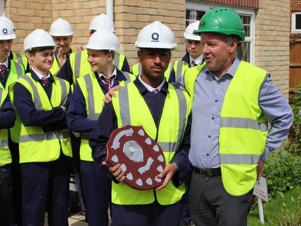 BRIGHT FUTURE. Year 11 Arnewood School student Hartley Wiseman (centre holding shield) has won a promising young constructor award from New Forest-based firm Pennyfarthing Homes. He is congratulated by his fellow construction students from Arnewood and Andy Follett (left), Construction Manager from Pennyfarthing Homes.