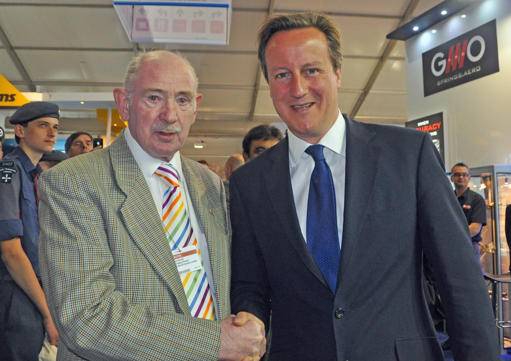 Barnbrook Systems Ltd managing director Anthony Barnett with Prime Minister David Cameron on opening day of Farnborough International Airshow 2014