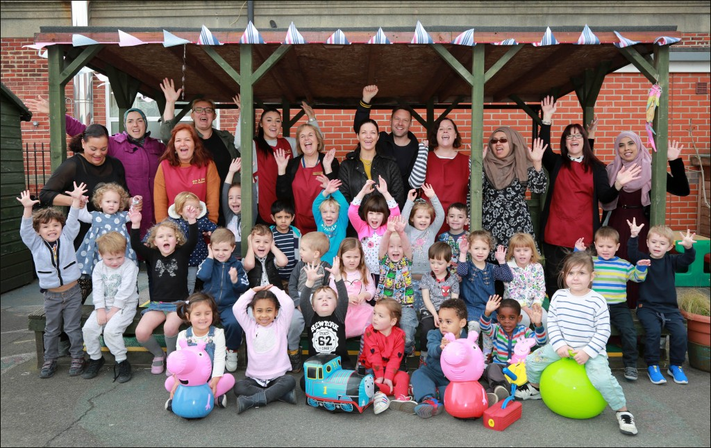 Jack and Jill Pre-school celebrate their new sponsorship from Bladez Toyz, pictured with staff, helpers and children are Emma Costello and Iain Morgan from the company.