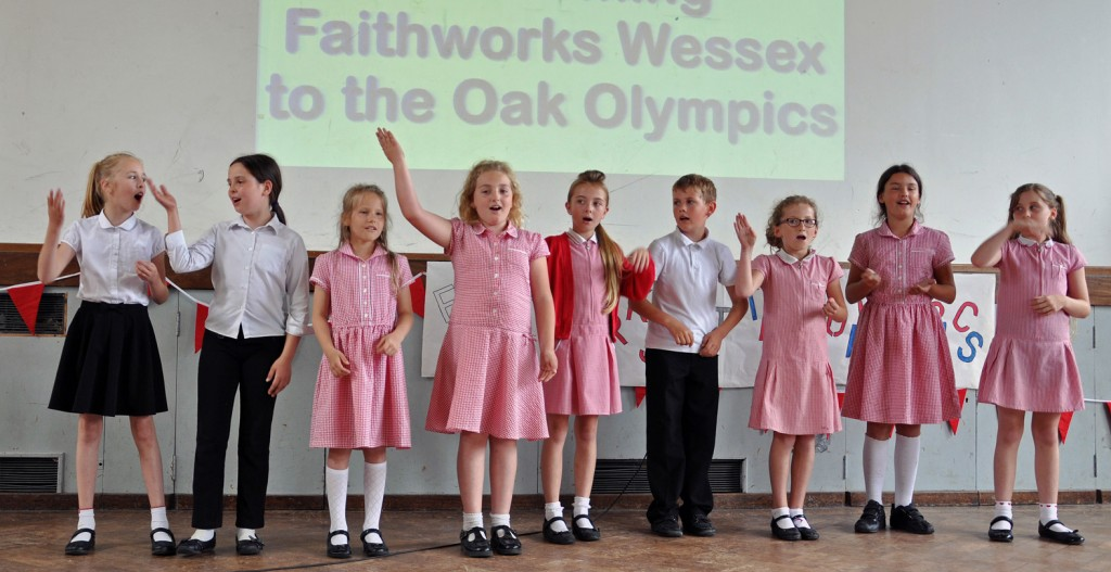 CELEBRATIONS: Students from the LeAF Academy hosted a special summer Olympics party for older members of the local community. Here children from Elm Academy sing to the guests.
