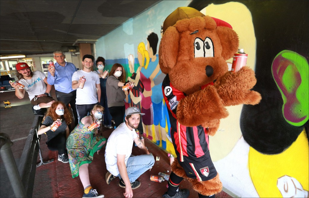 Cherry Bear joined sixth form students from Avonbourne College and MBN artists to help create a mural to brighten up the car park at the Sovereign Centre shopping precinct in Boscombe.