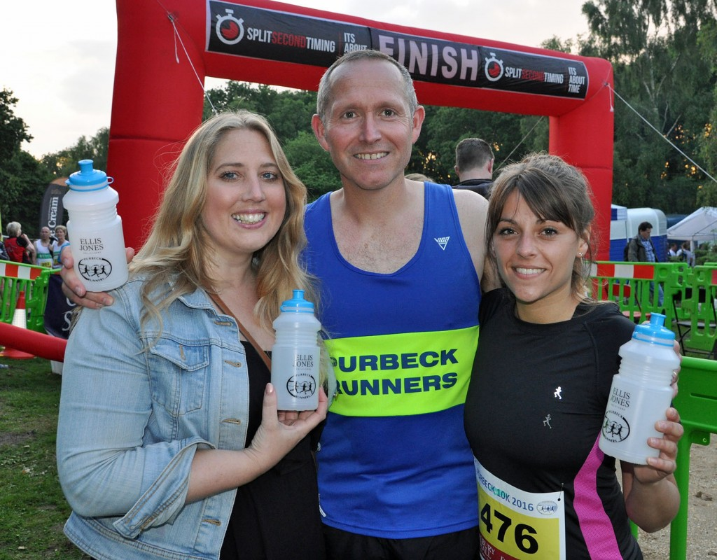 Lot of bottle: Craig Wells, Partner, Ellis Jones Solicitors, who competed in the Purbeck 10k with Charlotte Whiteway, conveyancing secretary (right) while secretary Emma Fidler helped out at the annual event.