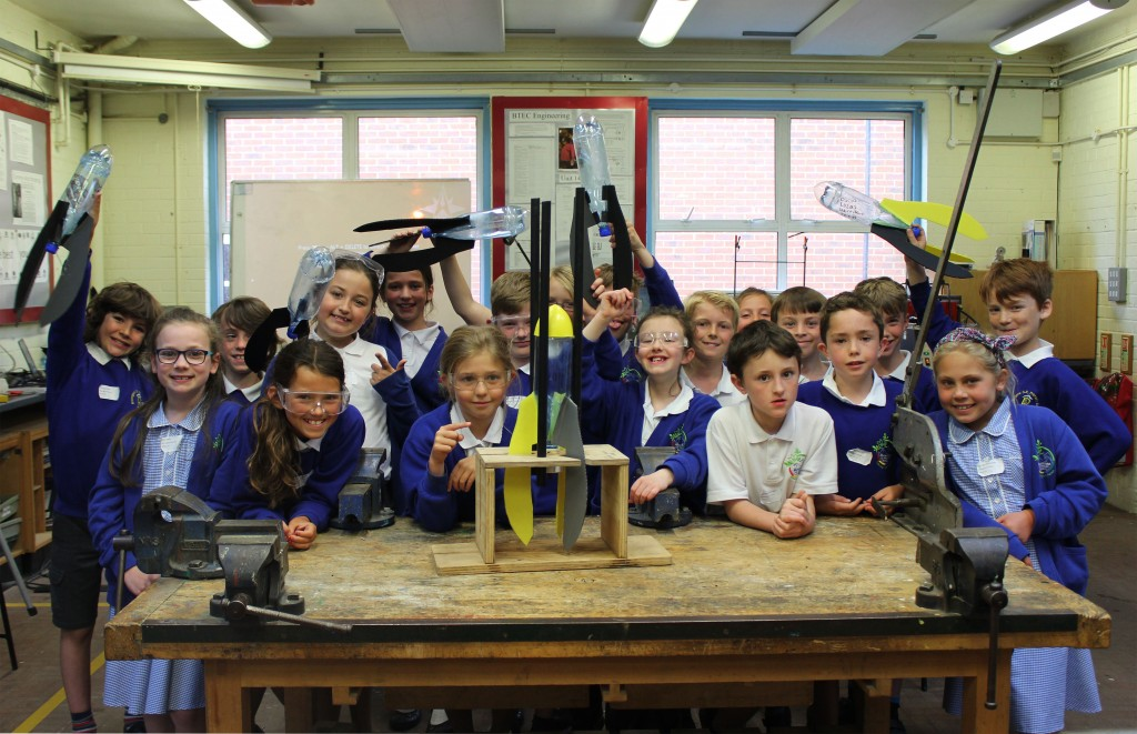 LAUNCHING INTO SECONDARY EDUCATION. Children from Bransgore Primary School and the water rockets they made at The Arnewood School's annual STEM Day.