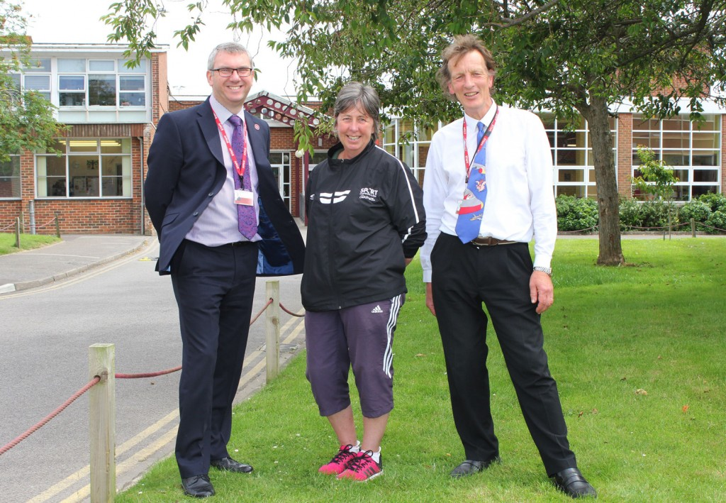 FOND FAREWELL: Headteacher of The Arnewood School Nigel Pressnell (left) says farewell and thank you to two of the school's longest members of staff, PE teacher Sarah Conacher (centre) and science teacher Rob Williamson (right).