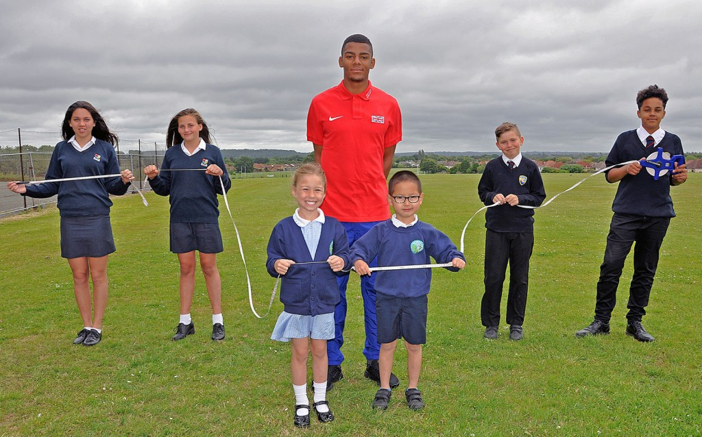 GREATH LENGTHS OF SUPPORT. Avonbourne Trust is getting behind Sixth Form student and long jump star Patrick Sylla (centre) as he embarks on an international sporting career. Here he is pictured with younger children from the Trust's schools: Avonwood Primary, Avonbourne College and Harewood College holding a tape measure of 7.61m length - Patrick's longest jump.