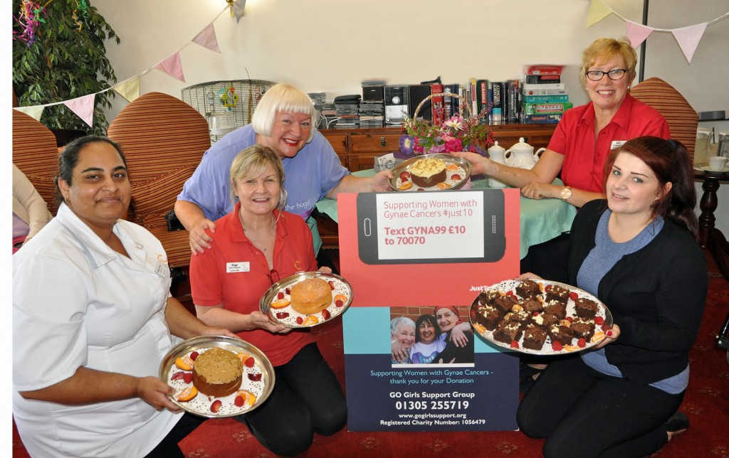 Piece of cake: Hilary Maxwell of GO Girls Support Group (third left) with (left to right) Ashika Reddy, Castle View's Clinical Lead; Angela Moors, Colten Companion; Sue Goodwin, Activity Organiser, and volunteer Jess Larder.