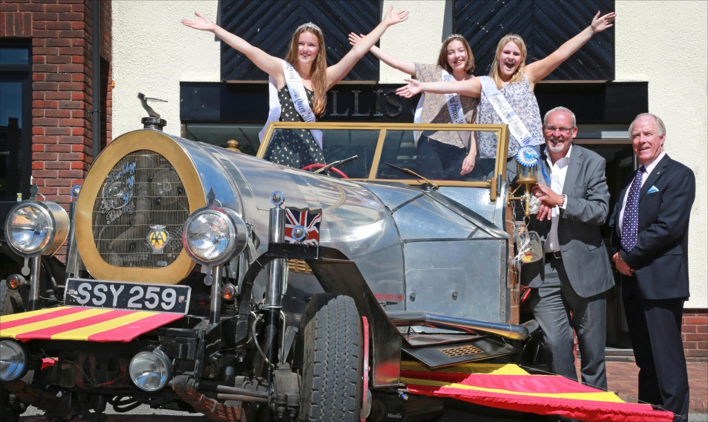Truly Scrumptious: Ringwood Carnival Queen Abbie Wilson (left) with attendants Ellen Puddle and Charlie James; Ellis Jones' Managing Partner Nigel Smith; Ringwood Carnival President Michael Lingam-Willgoss and the replica Chitty Chitty Bang Bang car.