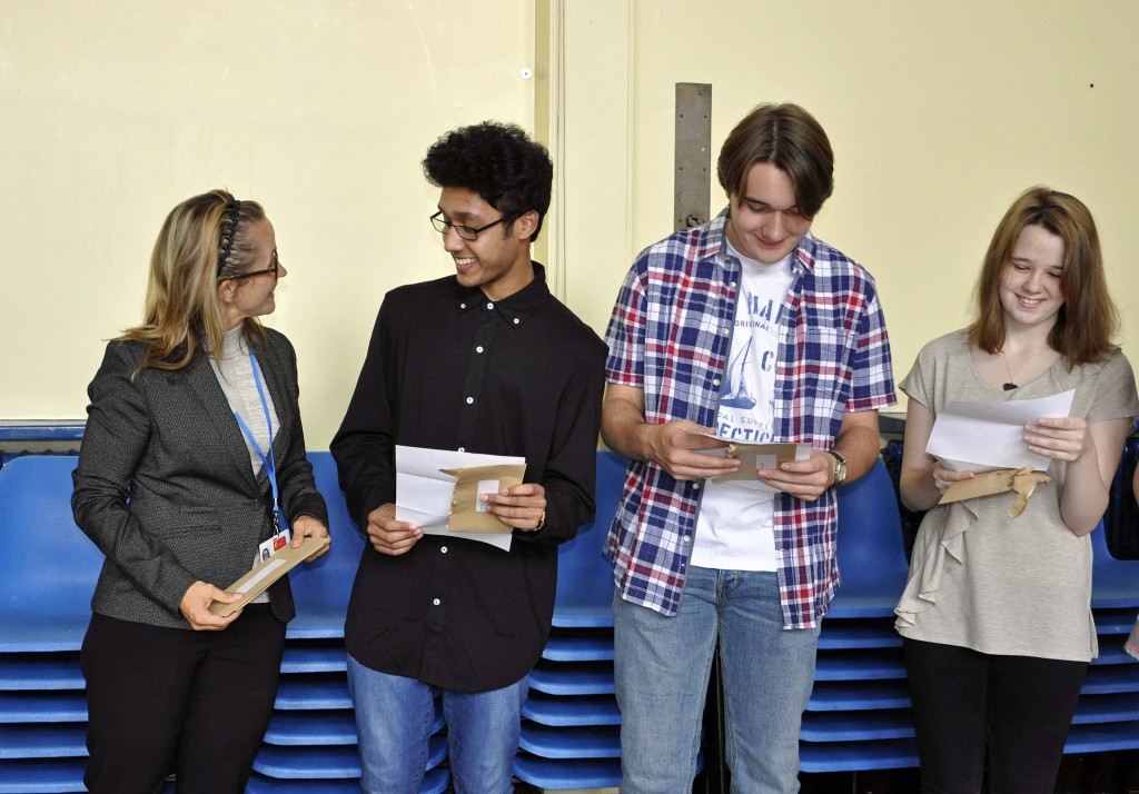 """his trio of Oak Academy students look pleased with their GCSE results as they share their success with one of their teachers. From second left to right: Idris Khan who achieved six As and four Bs. Idris, who would like to be a software engineer, will now take A-levels in Computer Science, Maths and Physics. Kieran Burgess who scored five As and four Bs; his A-levels will be in History, Sociology, Philosophy and Ethics and English Literature and Language. Kieran would like to be a teacher and was inspired by Oak Academy Science teacher Mr King, who he described as """"a geezer.""""  Maddison Cook who scored five As, three Bs and one C; her A-levels will be in Chemistry, Biology, Sociology and Applied Sciences and she would like to go on to study medicine."""