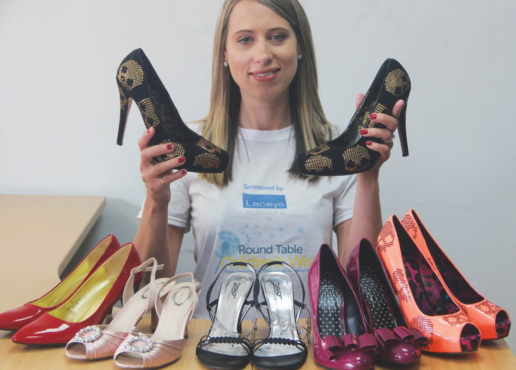 Samantha Read, fundraising officer at Round Table Children's Wish, with a selection of ladies' party shoes up for sale at the One Night Party Shoe Shop on September 22. Round Table Children's Wish grants handcrafted wishes to children aged four to 17 with life-threatening illnesses. Picture by Deep South Media account manager Neil Walton.