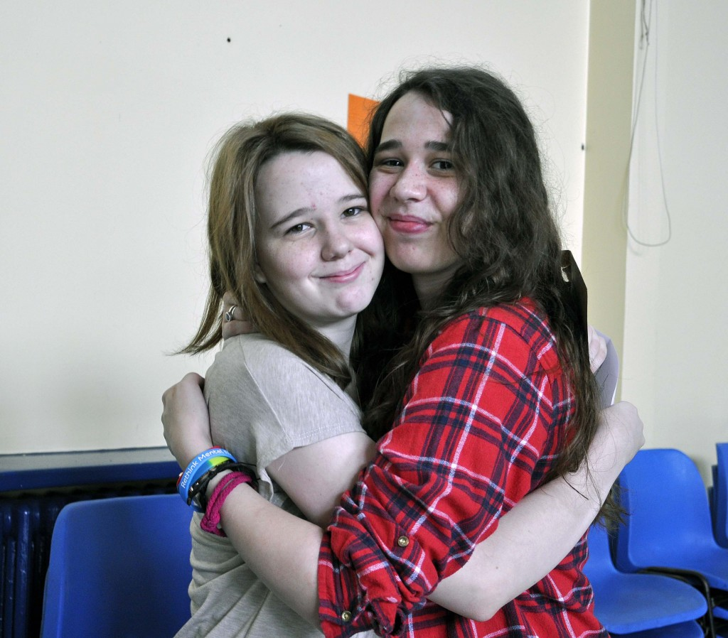 Oak Academy student Maddison Cook celebrates her outstanding GCSE results with her older sister.