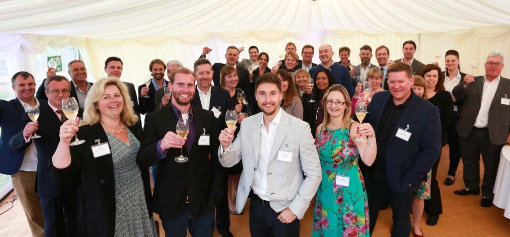 CHEERS: Hybrid Legal's summer drinks party at Hambledon Vineyard with, front from left, Employment Associate Laura Bowyer, Director Matt Schrader, Managing Director Ryan Lisk and Office Manager Charlotte Wills flanked by clients and colleagues.