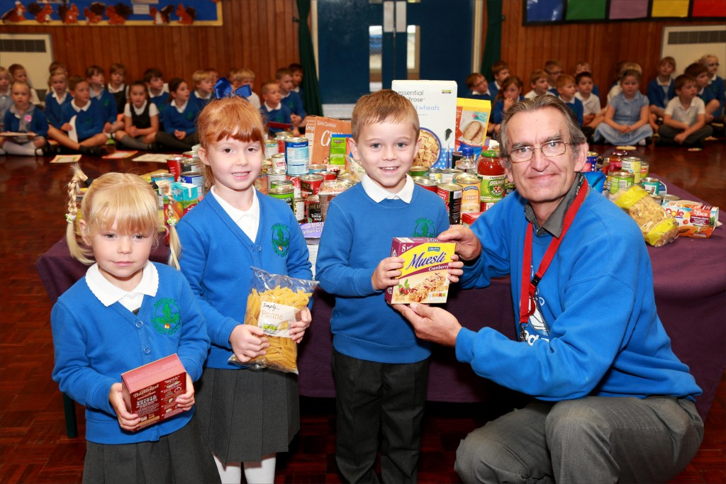 Pupils from Merley First School took part in a special Harvest Festival assembly before presenting Rev Robert Jones with the food they had collected to donate to Wimborne Food Bank.