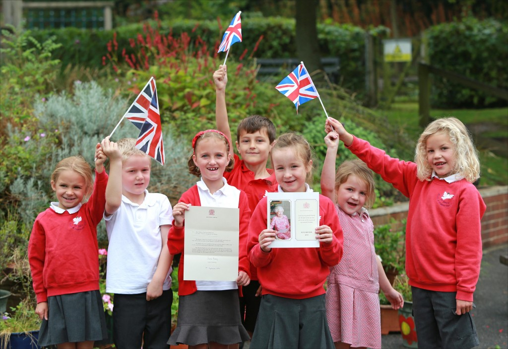 ROYAL THANKS. St John's First School in Wimborne celebrated receiving a letter from the Queen to thank them for the card sent to her to commemorate her 90th birthday. Part of the school worship team are pictured with the correspondence.