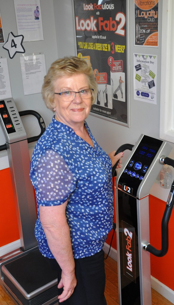 Wendy Percey from Lesley Shand Funeral Directors in Corfe Mullen trying out one of the Good Vibration machines that will be at the 50-plus information day in Broadstone.